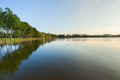 Lake view at sunset timing with tree. Located Bangkok Thailand royalty free stock images