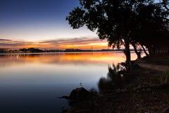 Lake view at sunset timing with tree. Located Bangkok Thailand stock image