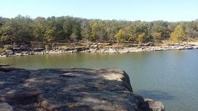 Lake. View of lake water shoreline from rock royalty free stock photos