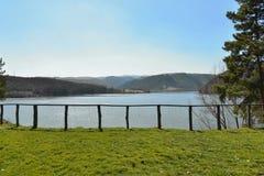 Gilau lake view through wooden handrail Royalty Free Stock Photo