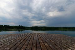 Lake. View from wooden pier on a lake during stormy weather Stock Photos