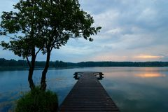 Lake. View from wooden pier on a lake during stormy weather Stock Image