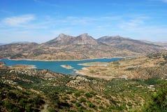 Lake view, Zahara de la Sierra, Andalusia, Spain. View across olive trees and the reservoir towards the mountains, Zahara de la Sierra, Cadiz Province Stock Photos
