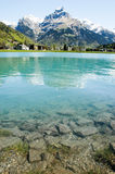 Lake at the village of Engelberg Stock Photos