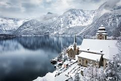 The lake and the village of Hallstatt, Austria. Snow covered in winter time Royalty Free Stock Image
