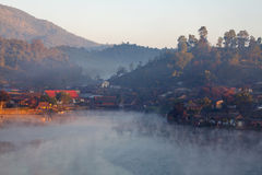 Lake village in morning at Ban Rak Thai Mae. Hong Son, Thailand Stock Photo
