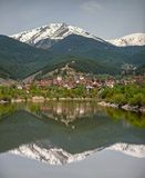 Lake, village and a mountain view Royalty Free Stock Photography