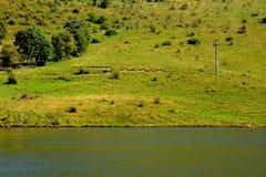 Lake in the village Rosia Montana, Transylvania Royalty Free Stock Photo