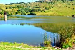 Lake in the village Rosia Montana, Transylvania Royalty Free Stock Photos