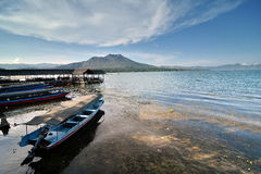 Lake by the Volcano. Lake Batur at Bali with Mount Batur in the background Royalty Free Stock Photos