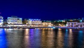 The lake Voulismeni in Agios Nikolaos, Crete, Greece. The lake Voulismeni in Agios Nikolaos at night with fullmoon, a picturesque coastal town with colorful Royalty Free Stock Images