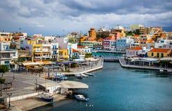 The lake Voulismeni in Agios Nikolaos,  Crete, Greece. The lake Voulismeni in Agios Nikolaos,  a picturesque coastal town with colorful buildings around the Stock Images