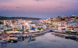 The lake Voulismeni in Agios Nikolaos, Crete, Greece. The lake Voulismeni in Agios Nikolaos,  a picturesque coastal town with colorful buildings around the port Royalty Free Stock Photos