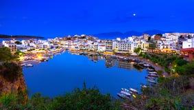 The lake Voulismeni in Agios Nikolaos, Crete, Greece. The lake Voulismeni in Agios Nikolaos,  a picturesque coastal town with colorful buildings around the port Stock Images