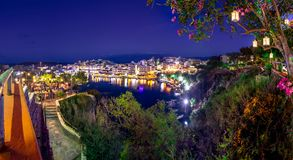 The lake Voulismeni in Agios Nikolaos at night with fullmoon, a picturesque coastal town with colorful buildings around the port. The lake Voulismeni in Agios Stock Photo