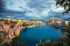 The lake Voulismeni in Agios Nikolaos,  Crete, Greece. The lake Voulismeni in Agios Nikolaos,  a picturesque coastal town with colorful buildings around the Royalty Free Stock Photo