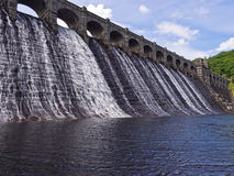 Lake Vyrnwy Dam Wall Wales UK. Scenic view from river level looking up at the dam wall across Lake Vyrnwy  reservoir. Wales, UK Royalty Free Stock Image