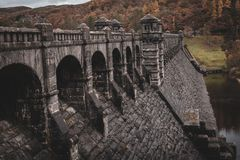 Lake Vyrnwy Magnificent Dam in Powys, Wales. Showing off its impressive overflow with the 1880s architecture, arches, shadows and leading lines stock photos