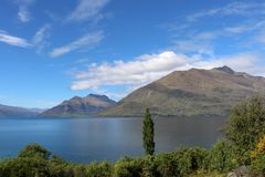 Lake Wakatipu and Cecil Peak, Otago, New Zealand. View from Kelvin Heights across part on Lake Wakatipu to Bayonet Peaks and Cecil Peak, mountains near Stock Photography