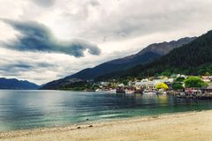 Lake Wakatipu coast view on a cloudy day in Queenstown stock photo