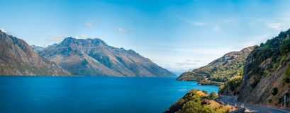 Lake Wakatipu Panorama, New Zealand. Panorama of Lake Wakatipu with the winding road along the lake shore, not far from Queenstown, in the Southern Island of New Royalty Free Stock Photo