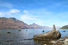 Lake Wakatipu Queenstown, New Zealand with rock balance. Queenstown with Wakatipu lake and Remarkables Mountains, New Zealand showing rocks balancing Royalty Free Stock Photos