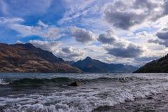 Lake wakatipu with view of walter peak and mount nicolaus royalty free stock photography