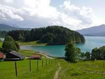 Lake Walchensee in the Bavarian Alps. The mysterious, turquoise coloured Lake Walchensee in the Bavarian Alps is so deep it never freezes in winter. However, it stock image