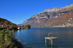 Lake Walensee and mountains of the Churfirsten range in autumn. Royalty Free Stock Photography