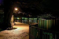 Lake walkway at night Stock Photo
