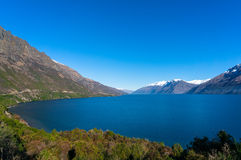 Lake Wanaka landscape with snow covered mountains Royalty Free Stock Photos