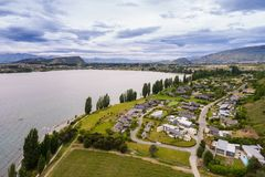 Lake Wanaka, New Zealand Panoramic Landscape. From aerial view captured by drone flying above Wanaka City. Wanaka is a popular resort of New Zealand, and is Stock Photo