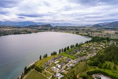 Lake Wanaka, New Zealand Panoramic Landscape. From aerial view captured by drone flying above Wanaka City. Wanaka is a popular resort of New Zealand, and is Stock Photography