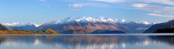 Lake Wanaka Panorama, New Zealand. Early morning panoramic view of New Zealands most beautiful Lake Wanaka. A hint of a Norwest wind in the clouds and the Royalty Free Stock Photo