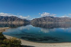 Lake Wanaka at summer sunny day, South island, New Zealand royalty free stock images