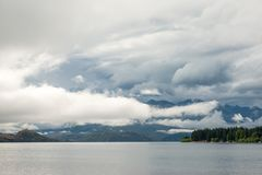 Lake Wanaka under the clouds. New Zealand is called Aotearoa or Land of the Long White Cloud in Maori. Lake Wanaka, South Island, is surrounded by mountains that royalty free stock photography