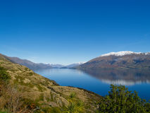 Lake Wanaka view to snow capped hills. Royalty Free Stock Images