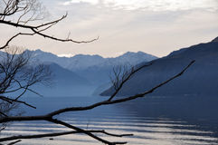 Lake Wanaka in Winter, New Zealand. Atmospheric view of Lake Wanaka, New Zealand in Winter. Ideally suited to mountain or lake background. The Hobbit and Middle Stock Images
