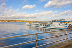 Lake Wannsee, Berlin. Berlin, Germany - October 27, 2013: View over the Lake Wannsee - the biggest in the hinterland of Berlin. Shipping pier with passenger ship stock photography
