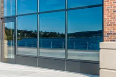 Lake Reflecton. Lake Washington is reflected in building windows in Renton, Washington royalty free stock photography