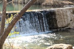 Lake Water Cascade. Turquoise lake water cascading over travertine rocks Royalty Free Stock Photography