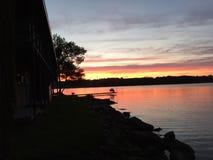 Lake water dock sunset night dusk clouds Stock Image