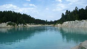 Lake and water inside mountains in deep forest Stock Photo