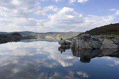Lake with water reflexion. Lake with natural water reflecting sky and clouds Royalty Free Stock Images