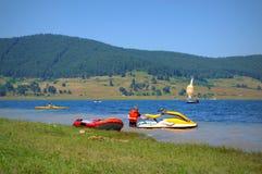 Lake water sports. People having fun boating in Batak lake,Bulgaria Royalty Free Stock Image