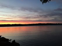 Lake water sunset night dusk clouds Royalty Free Stock Photo
