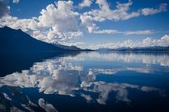 Lake Water Under White and Blue Skies during Daytime Royalty Free Stock Image