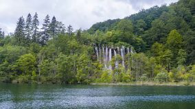 Lake with a waterfall stock images