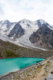 Lake and waterfall in forest, mountains of Caucasus, Russia Royalty Free Stock Photos