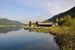 Lake Weissensee, Austria. Image shows panoramic view to lake Weissensee with white church in Austria, Techendorf, Carinthia Royalty Free Stock Photography